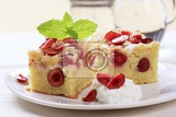 Photo slices of freshly baked cherry sponge cake