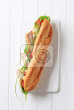 french bread filled with vegetables and chicken strips