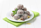 nobake chocolate snowball cookies rolled in coconut