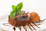 brownie with chocolate curls and ice cream