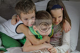 Fotografie Bunch group of kids children leaned holding hugging together on bed