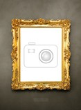 Fotografia ornate picture frame hanging on a wall