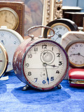 Fotografie selection of vintage clocks at flea market