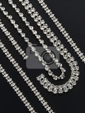 display of silver necklaces and bracelets with shiny gemstones