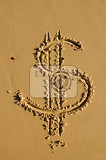 dollar sign drawn in the sand  closeup