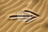arrow sign drawn in the sand  closeup