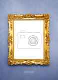 Fotografie ornate picture frame on a blue wall