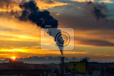 Fotografie sunrise silhouette of city landscape with smoking factory ecology pollution concept