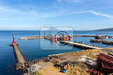 Fotografie view of indian ocean harbor in kota manado city indonesia with blue sky and volcano in background