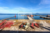 Photo view of indian ocean harbor in kota manado city indonesia with blue sky and volcano in background