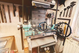 Fotografie real domestic diy home workshop full of tools untidy ready for work detail of homemade lathe retro vintage color tone