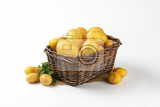 raw potatoes in wicker basket