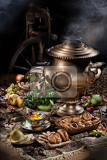 Fotografie still life with water boiler spinning wheel and fruits made by light brush