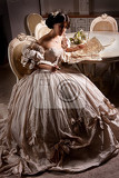 Fotografie young beautiful woman in a wedding dress sitting at the round table
