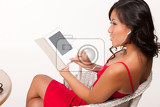 young brunette woman reading the electronic book on isolated background