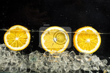slices of oranges in the water with ice
