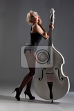 Fotografia young woman in a black underwear with a double bass