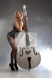 young woman in a black underwear with a double bass