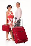 Fotografie young woman and man with a tourist suitcase on isolated background