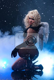Fotografie young woman in black shiny clothing with white wings