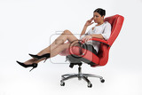 Photo young attractive woman sitting on a red office armchair