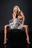 young nude blonde woman sitting on bentwood chair