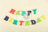 Fotografie birthday cake with text happy birthday for thirteen anniversary on white