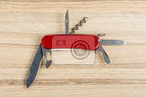 Photo multipurpose knife on wooden background with all neccessary tools all in one