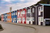 Fotografie colored crab fisher hutches at harbor island helgoland germany nordic style houses with boat and blue sky