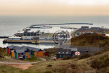 Photo harbor island helgoland germany nordic style houses with boat and blue sky view from hill to north sea