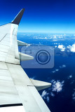 Fotografie heavenly scene flying aircraft wing in a white clouds on blue sky