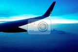 Fotografie heavenly scene flying aircraft wing in a white clouds on blue sky evening scene with sunset