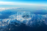 Fotografie big white cloud and blue sky backgroundview from airplane earth view blue and white clouds