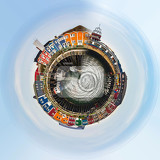 planet of panorama of colored crab fisher hutches at harbor island helgoland germany nordic style houses with boat and blue sky little planet concept tiny planet projection