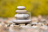 pile of balancing pebble stones like zen stone outdoor in spring spa wellness tranquil scene soul equanimity concept mental calmness