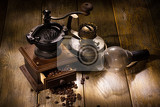 Fotografie coffee mill and old oil lamp on a wooden table