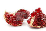 part of tasty pomegranate fruit on white background