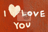 inscription i love you with abstract heart on the paint wall