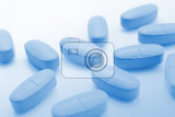 Fotografie medical blue background with pills