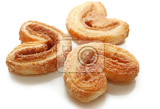 Fotografie sweet cookies with cinnamon in shape of hearts isolated on white