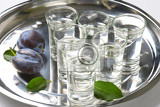 shots of plum brandy slivovitz on metal serving tray