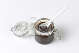 spoon in a jar of plum jam