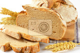 Fotografie closeup of homemade bread on wooden cutting board