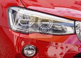detail headlights and fog light of sport red car
