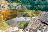 abandoned and flooded quarry czech republic teal and orange color tone beautiful landscape