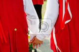 young lovers in folk costume holding hands on moravian feast