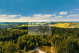 Fotografie aerial view from lookout u jakuba to czech landscape known as czech canada touristic place view to forest field and meadows in sunny day with blue sky