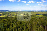 Photo aerial view from lookout u jakuba to czech landscape known as czech canada touristic place view to forest field and meadows in sunny day with blue sky