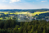 Fotografie aerial view from lookout u jakuba to czech landscape known as czech canada touristic place view to forest field meadows and small village in sunny day with blue sky