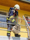 firefighter girl to contest pulls on a rope coiled fire hosecontest tfa  toughest firefighter alive